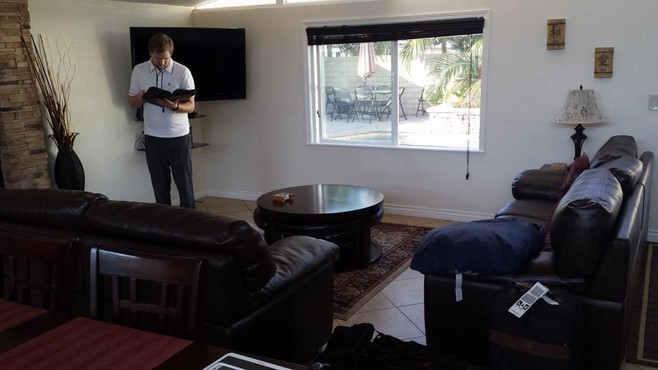 Living Room with Joel checking out our options of movies